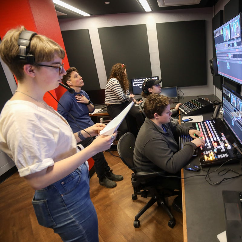 students working in a media studio