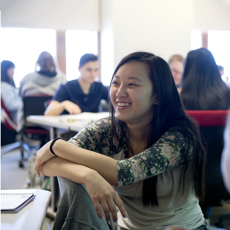 Smiling student in a classroom environment