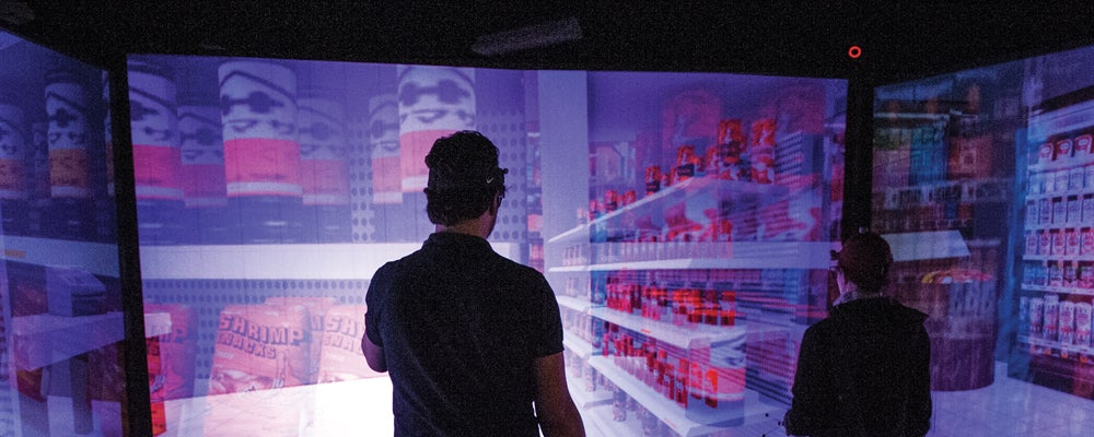 Man in front of a large scale interactive screen
