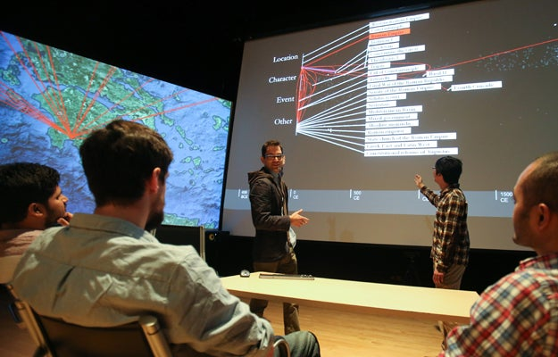 Students working with large data-visualization display