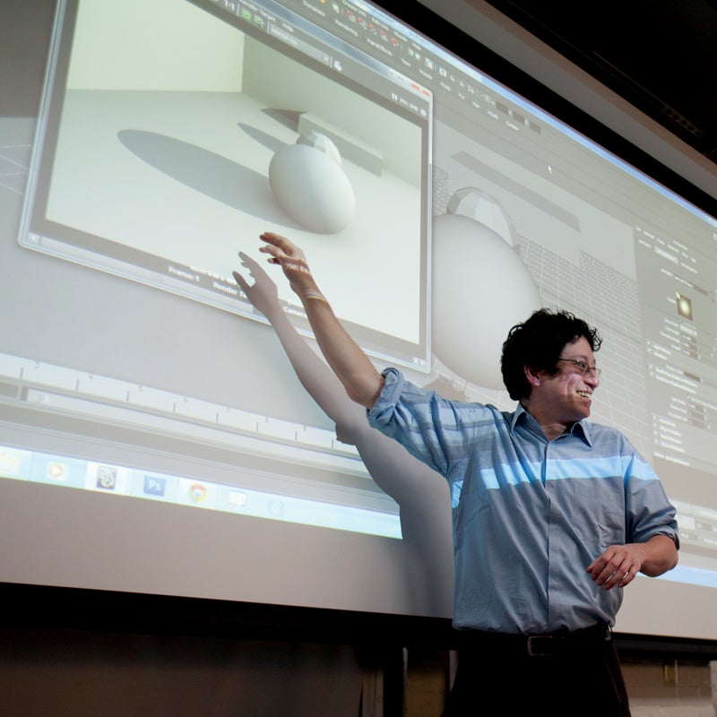 Professor showing students a video game interface