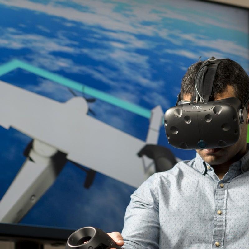 Student wearing a virtual reality headset using a flight simulator