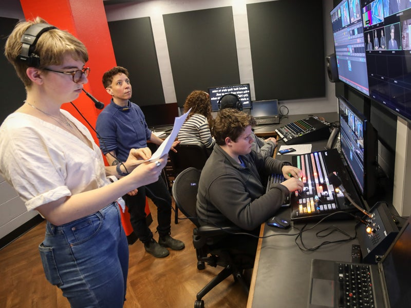 Students working in a media control room