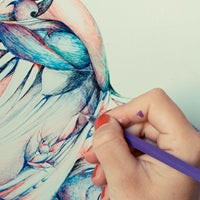 Student drawing with colored pencil