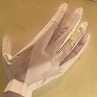 A hand made from a large-format printer paper
