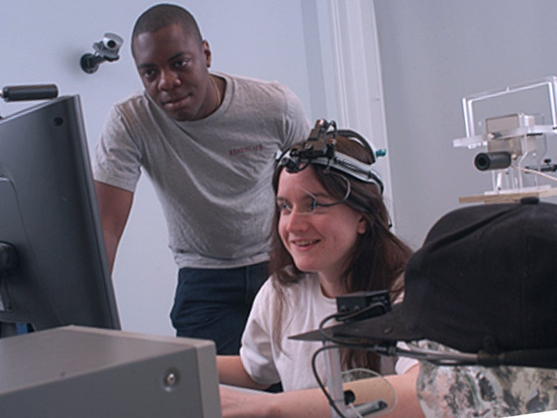 Two students, a male and a female, working with perception technology