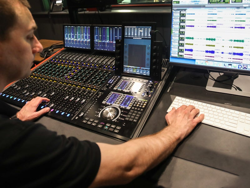 Student working on an audio board