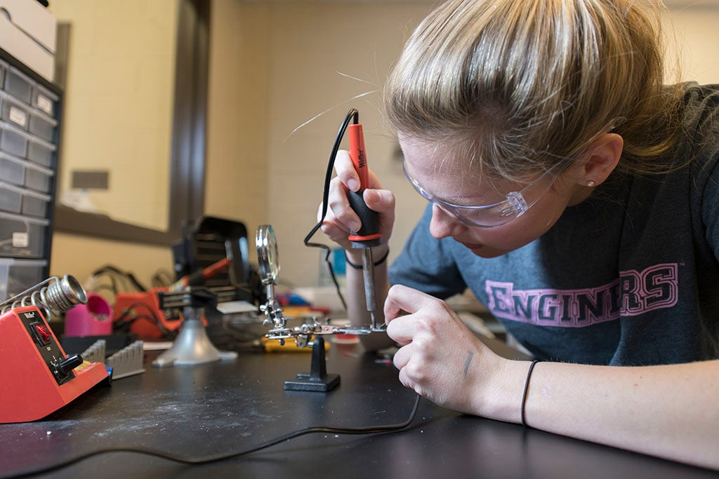 a student working at a soldering work station